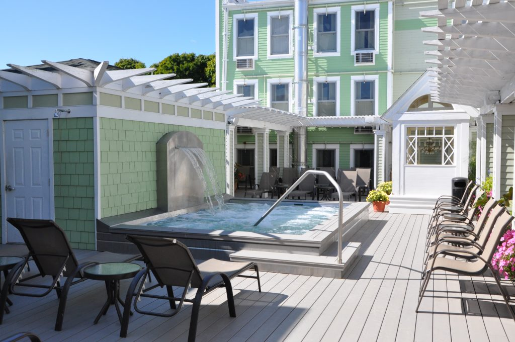 A heated spa pool with waterfall is on the sun deck at Mackinac Island's Murray Hotel.
