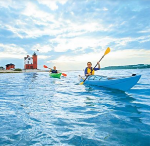 Round Island Lighthouse is a popular destination for paddlers on kayak tours around Mackinac Island.
