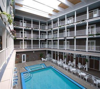 The indoor swimming pool at Mackinac Island's Lake View Hotel features a hot tub and sauna in the middle of a 4-story atrium.