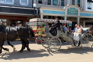 Horse-Drawn Carriage with Newly-Wed Couple on Mackinac Island