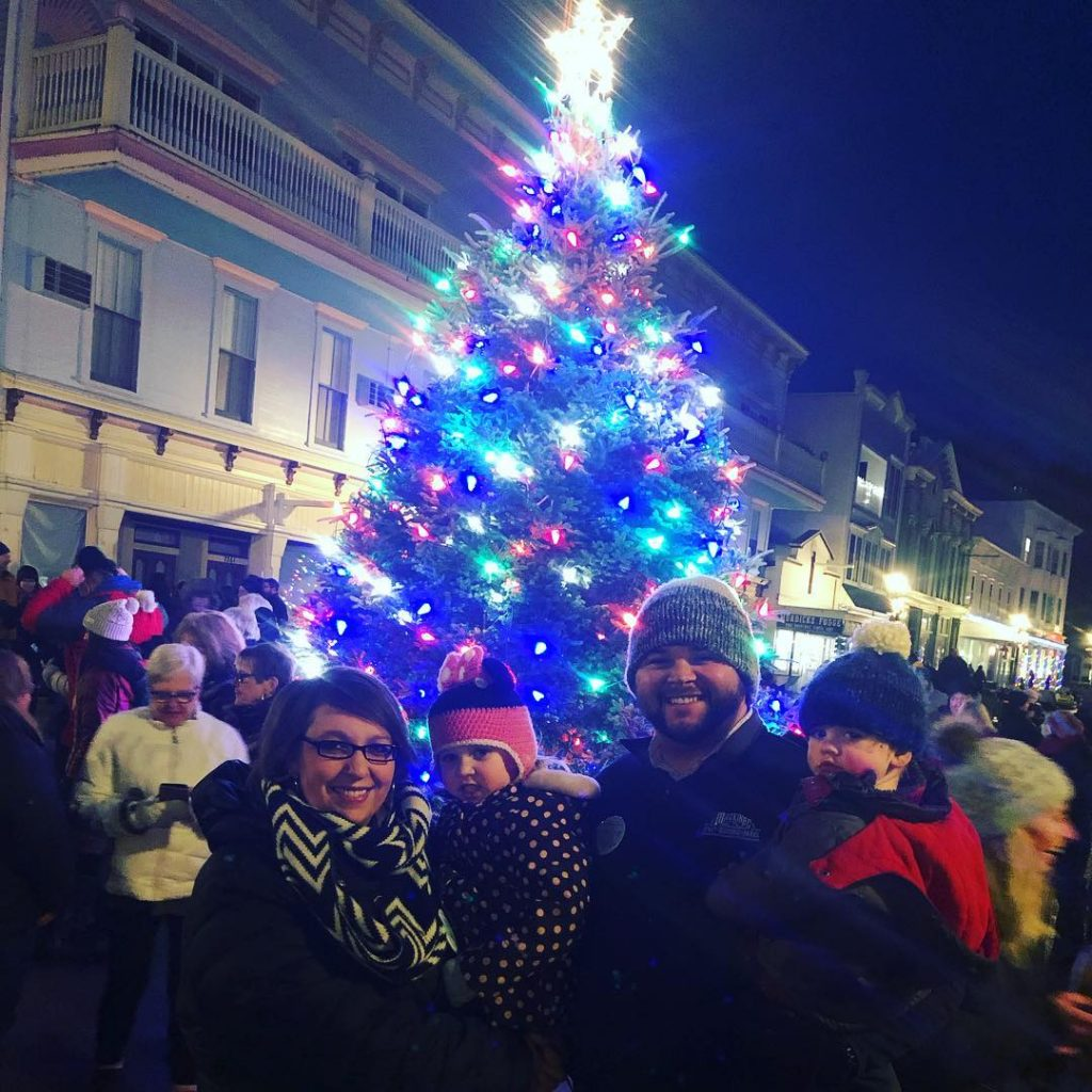 Visitors to Mackinac Island Posing for Photo in Front of Christmas Tree